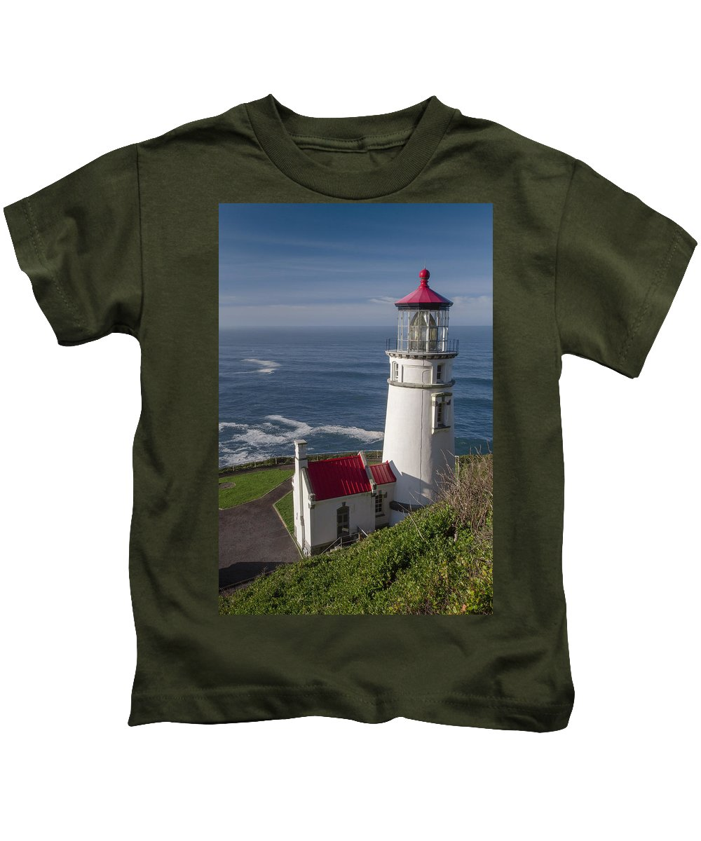 Lighthouse Kids T-Shirt featuring the photograph Haceta Head Lighthouse by Alex Hagerty