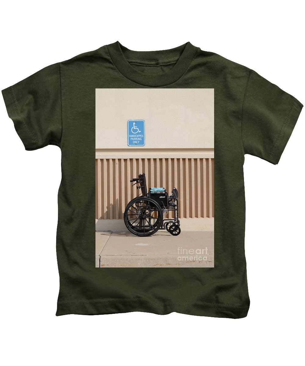 Wheelchair Kids T-Shirt featuring the photograph Handicapped Parking by Merrimon Crawford
