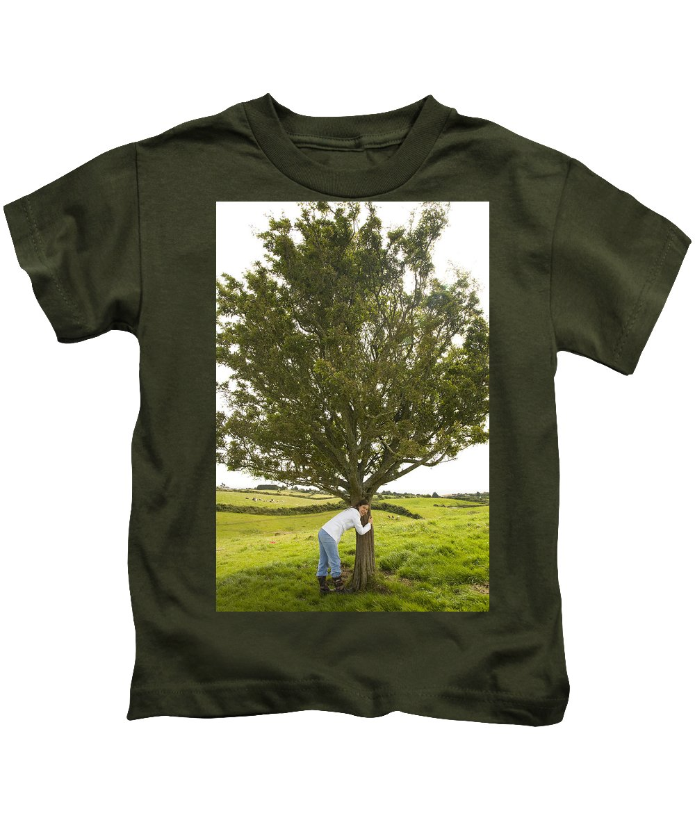 Green Kids T-Shirt featuring the photograph Hugging The Fairy Tree In Ireland by Ian Middleton