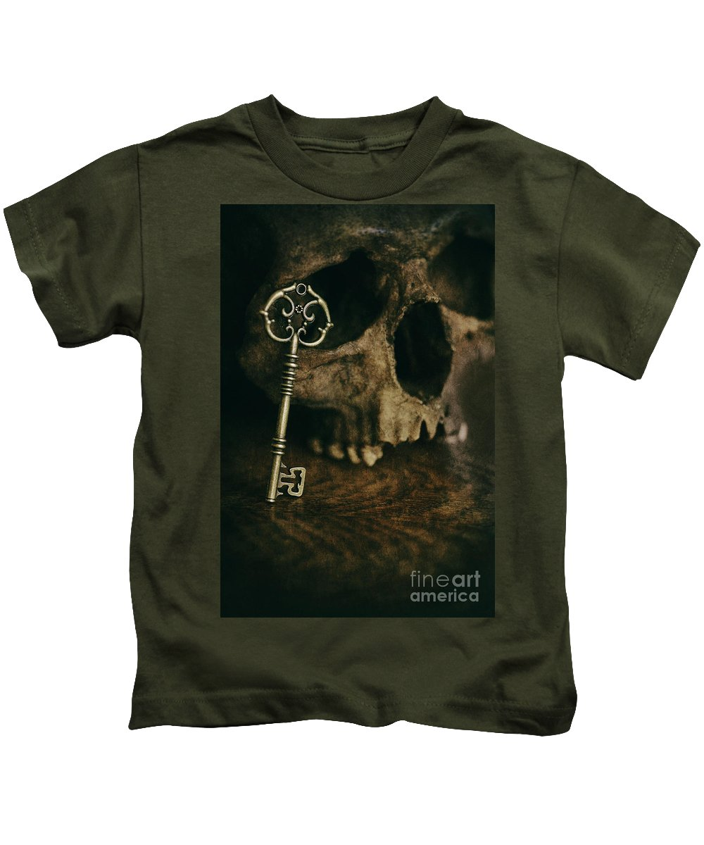 Human Kids T-Shirt featuring the photograph Human Skull With Vintage Key by Lee Avison