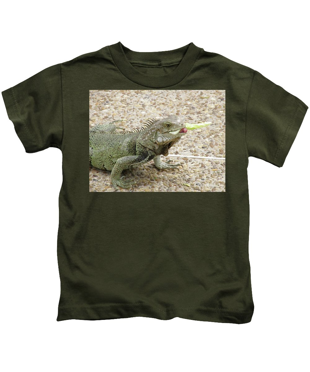 Iguana Kids T-Shirt featuring the photograph Iguana Eating Lettuce With His Tongue Sticking Out by DejaVu Designs
