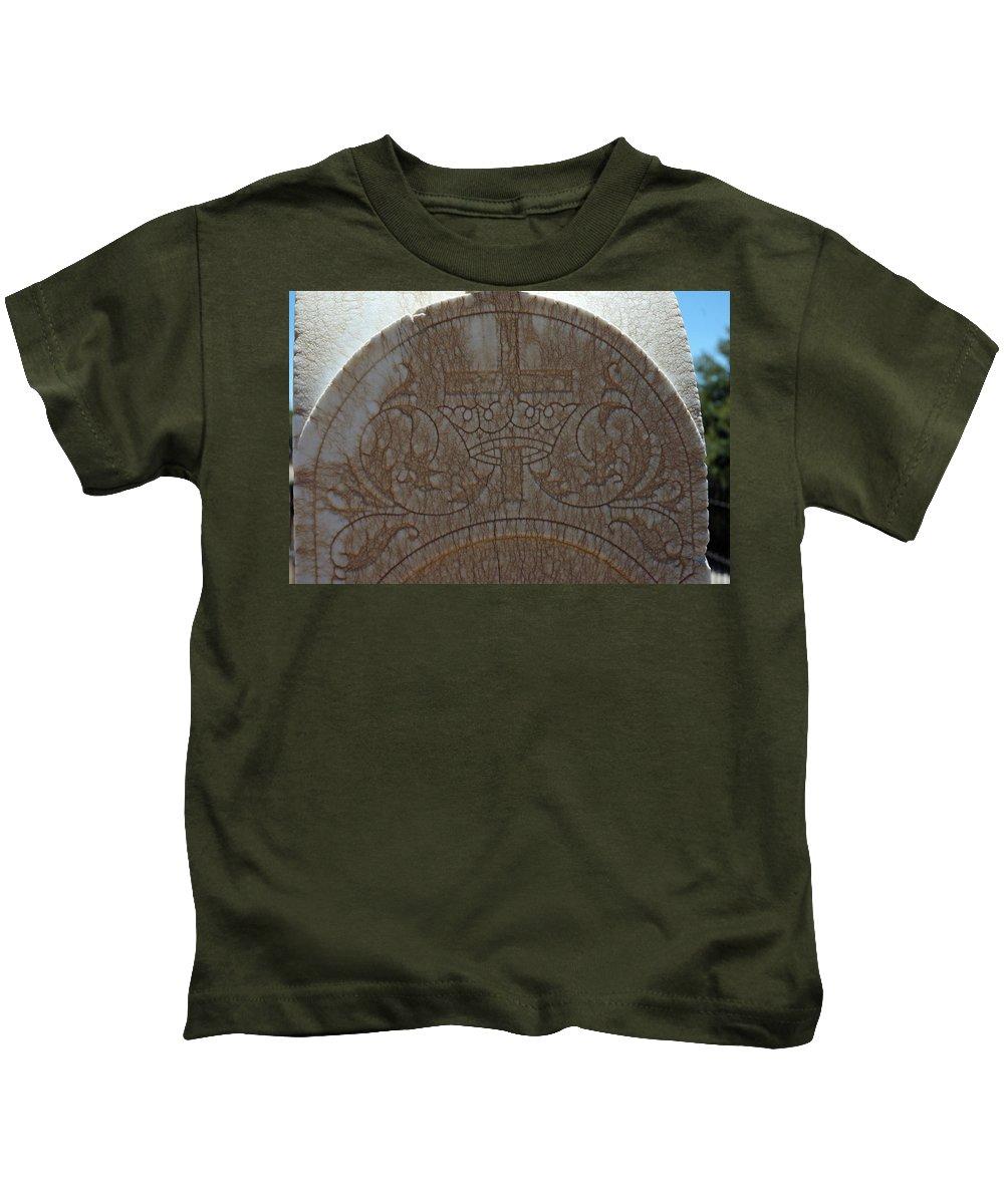 Usa Kids T-Shirt featuring the photograph In Stone Cross And Crown Virginia City Nv by LeeAnn McLaneGoetz McLaneGoetzStudioLLCcom