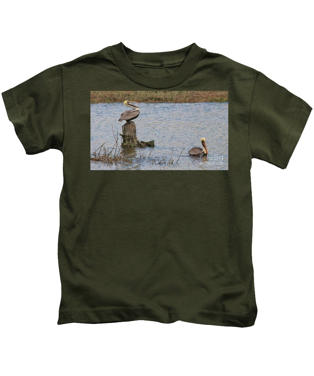 Pelican Kids T-Shirt featuring the photograph Laughing Because He Got The Post by Paulette Thomas