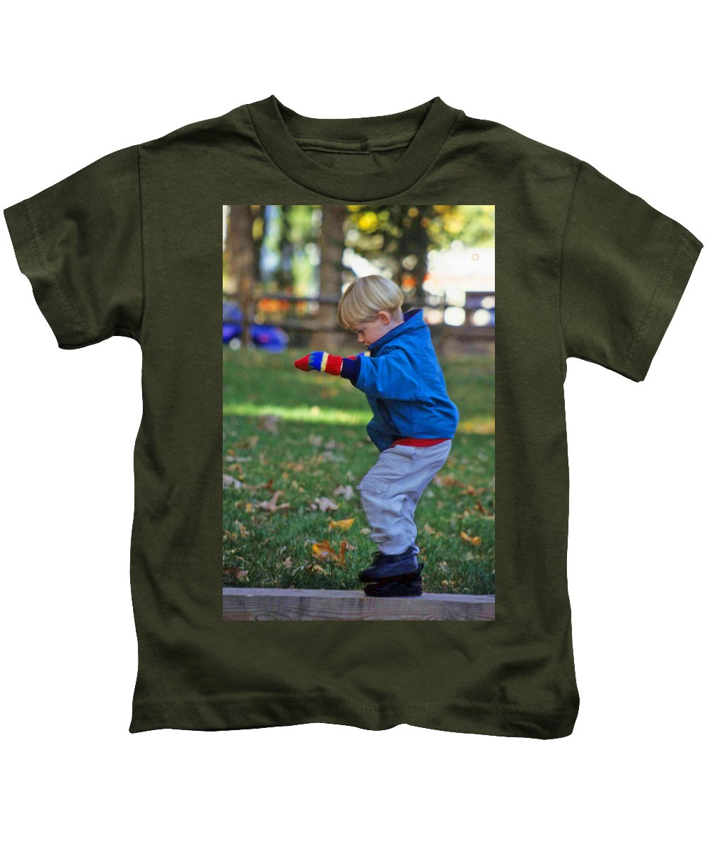 Boy Balancing Kids T-Shirt featuring the photograph Life In Perfect Balance by Laurie Paci