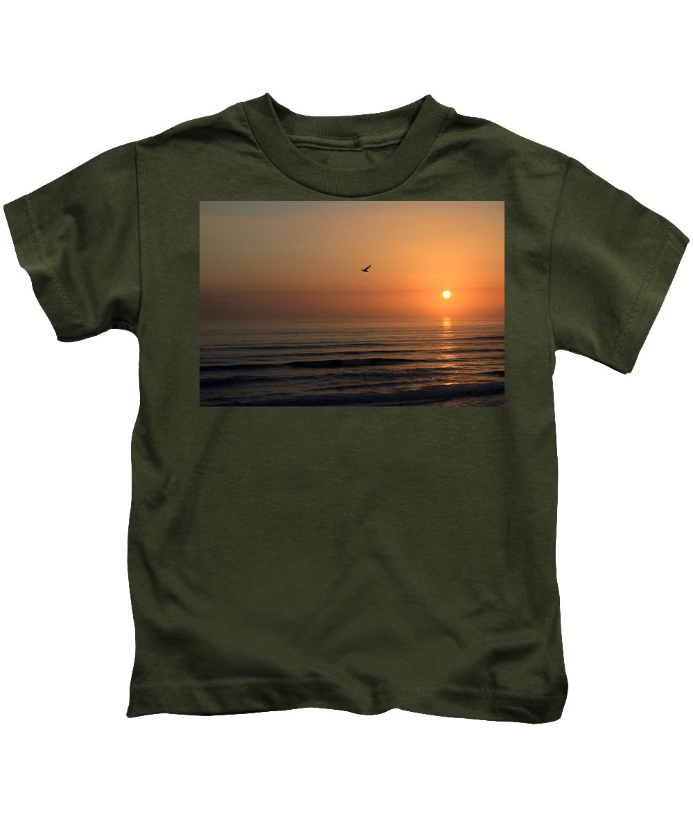Bird Fly Flight Gull Alone Sun Sunrise Sky Ocean Wave Reflection Nature Golden Gold Kids T-Shirt featuring the photograph Lonely Flight by Andrei Shliakhau