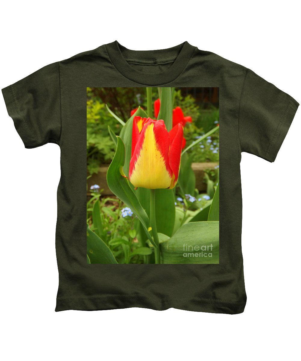 Spring Kids T-Shirt featuring the photograph Mister Tulip Waving Salute by Lingfai Leung