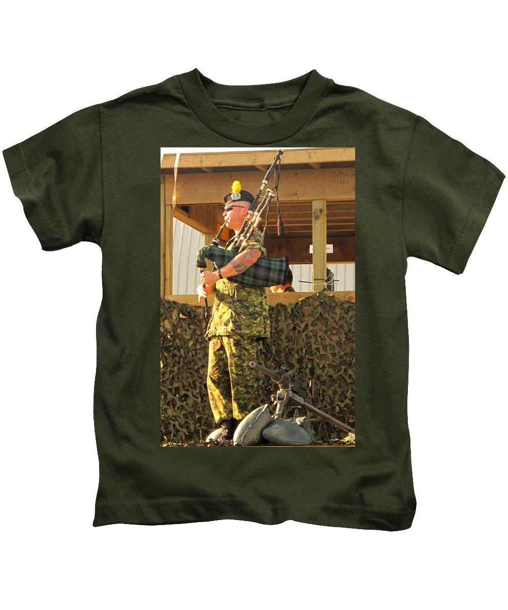 Machine Kids T-Shirt featuring the photograph Ode To A Machine Gun by Ian MacDonald