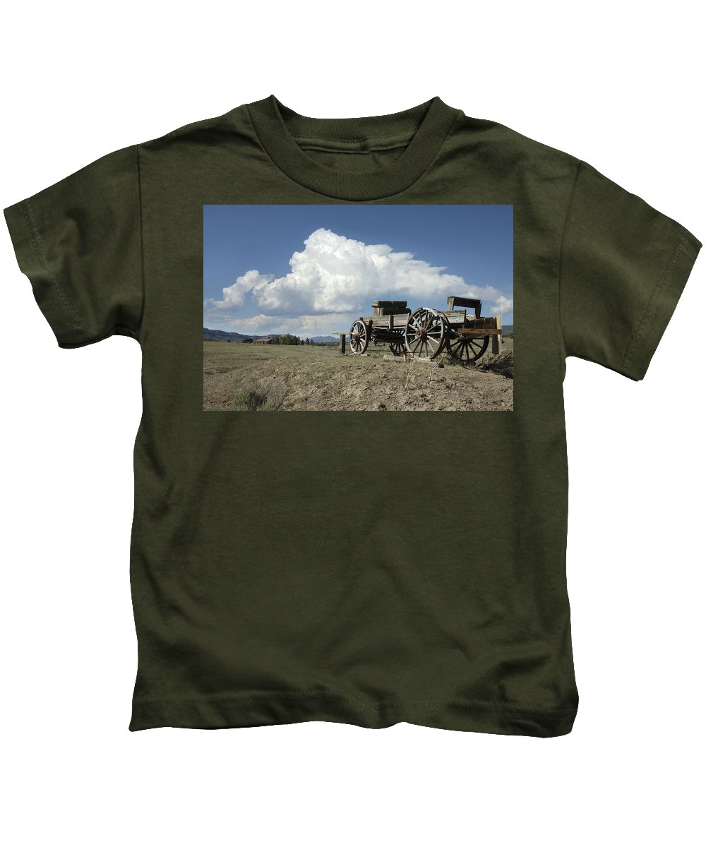 Wagon Kids T-Shirt featuring the photograph Old Wagon Out West by Jerry McElroy