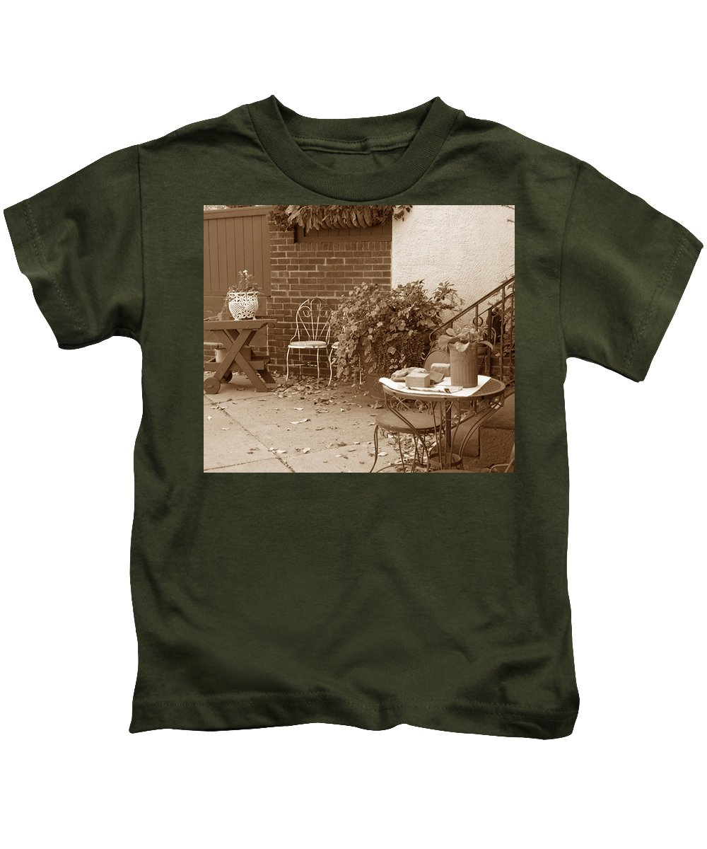 Sepia Kids T-Shirt featuring the photograph Patio Table by Janis Beauchamp