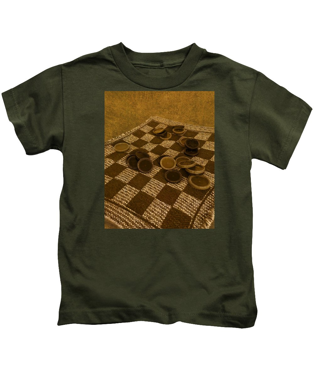 Checker Kids T-Shirt featuring the photograph Playing Checkers On A Rug by Mitch Spence