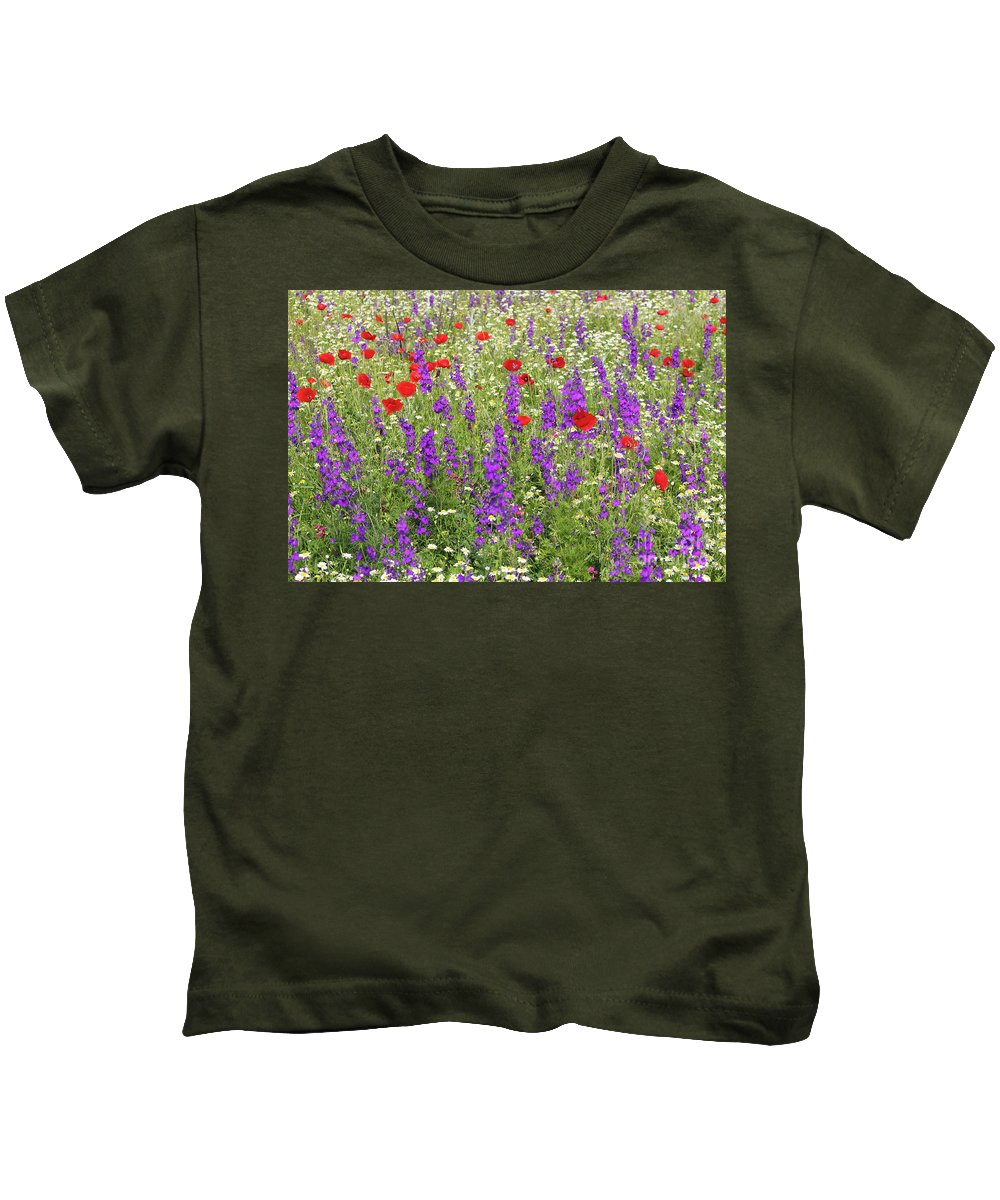 Camomile Kids T-Shirt featuring the photograph Poppy And Wild Flowers Meadow Nature Scene by Goce Risteski