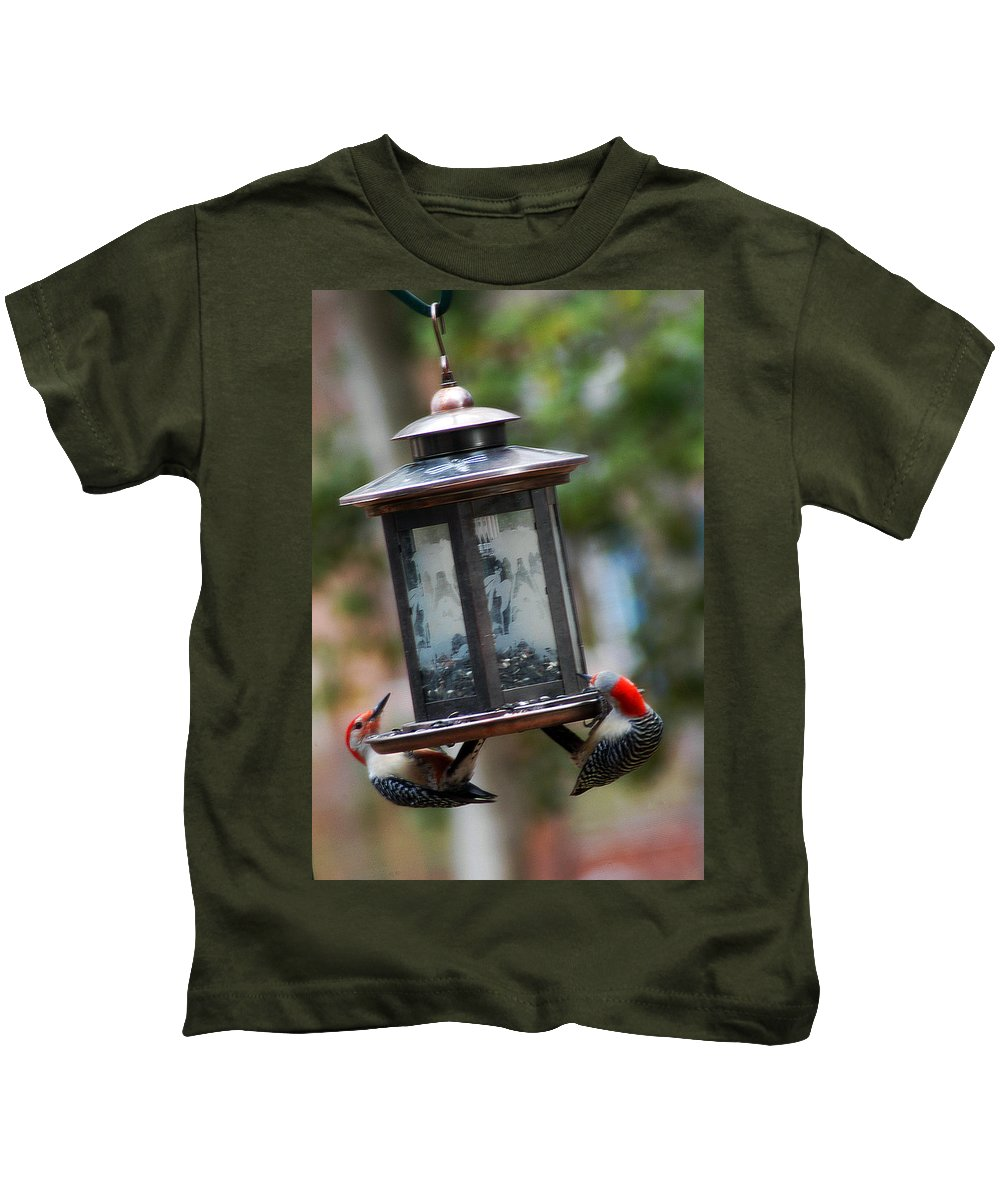 Clay Kids T-Shirt featuring the photograph Red Head Wood Peckers On Feeder by Clayton Bruster