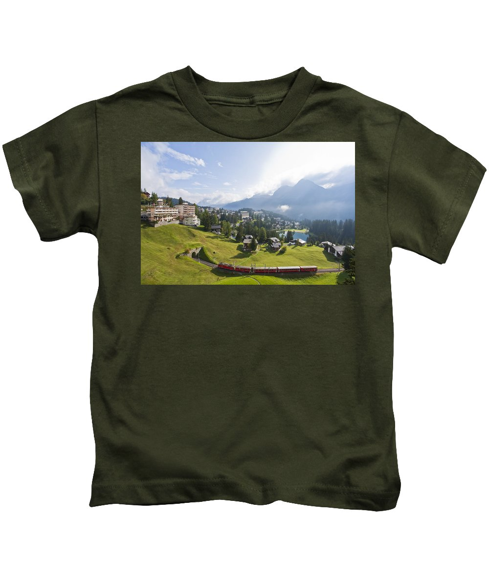 Townscape Kids T-Shirt featuring the photograph Rhaetian Railway In Arosa by Werner Dieterich