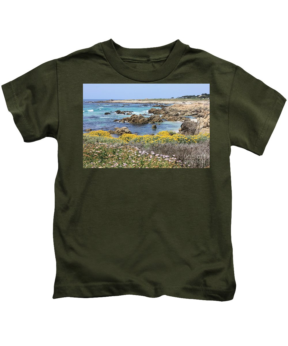 Ocean Kids T-Shirt featuring the photograph Rocky Surf With Wildflowers by Carol Groenen