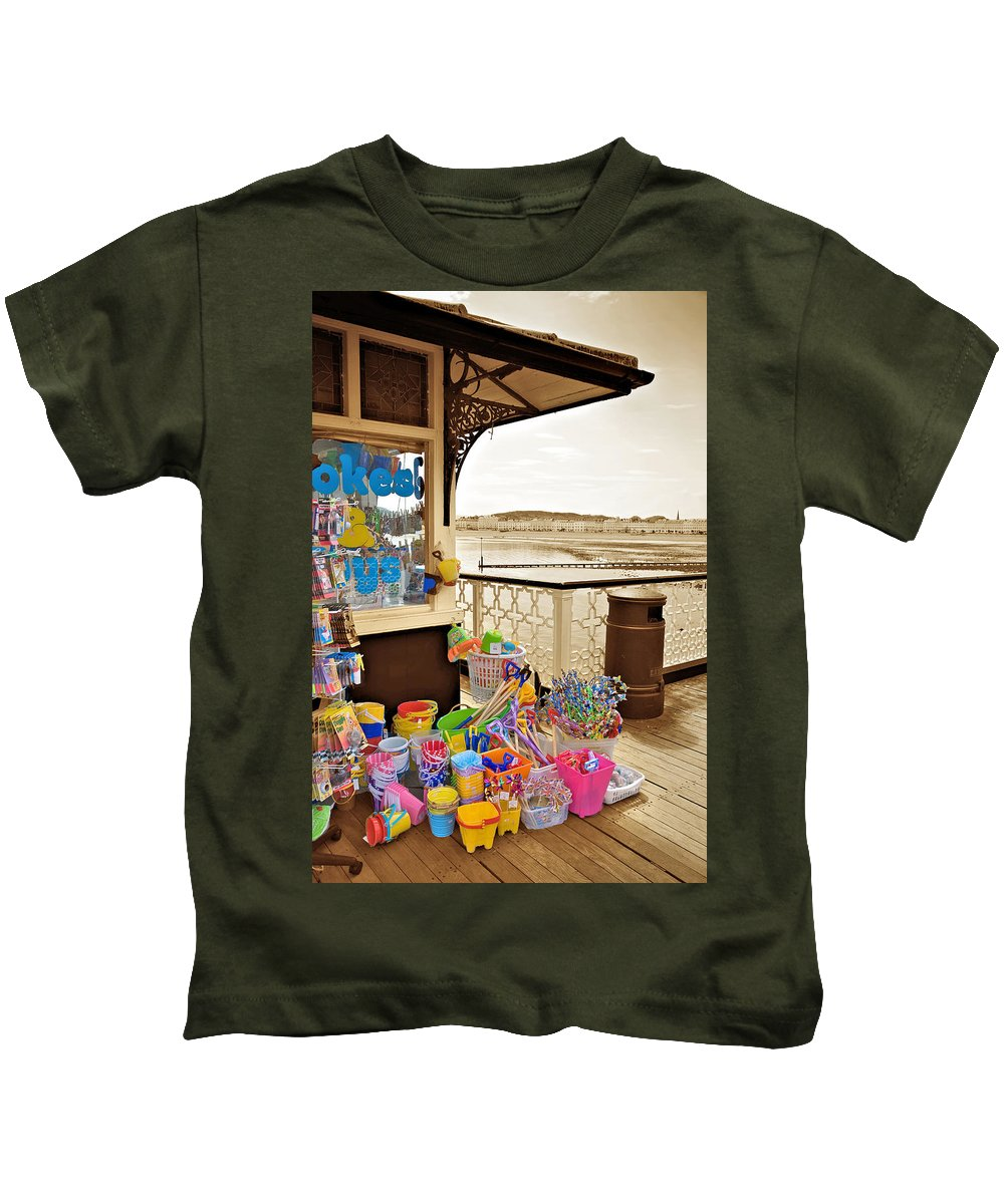 Seaside Kids T-Shirt featuring the photograph Seaside Buckets And Spades For Sale On Llandudno Pier by Mal Bray