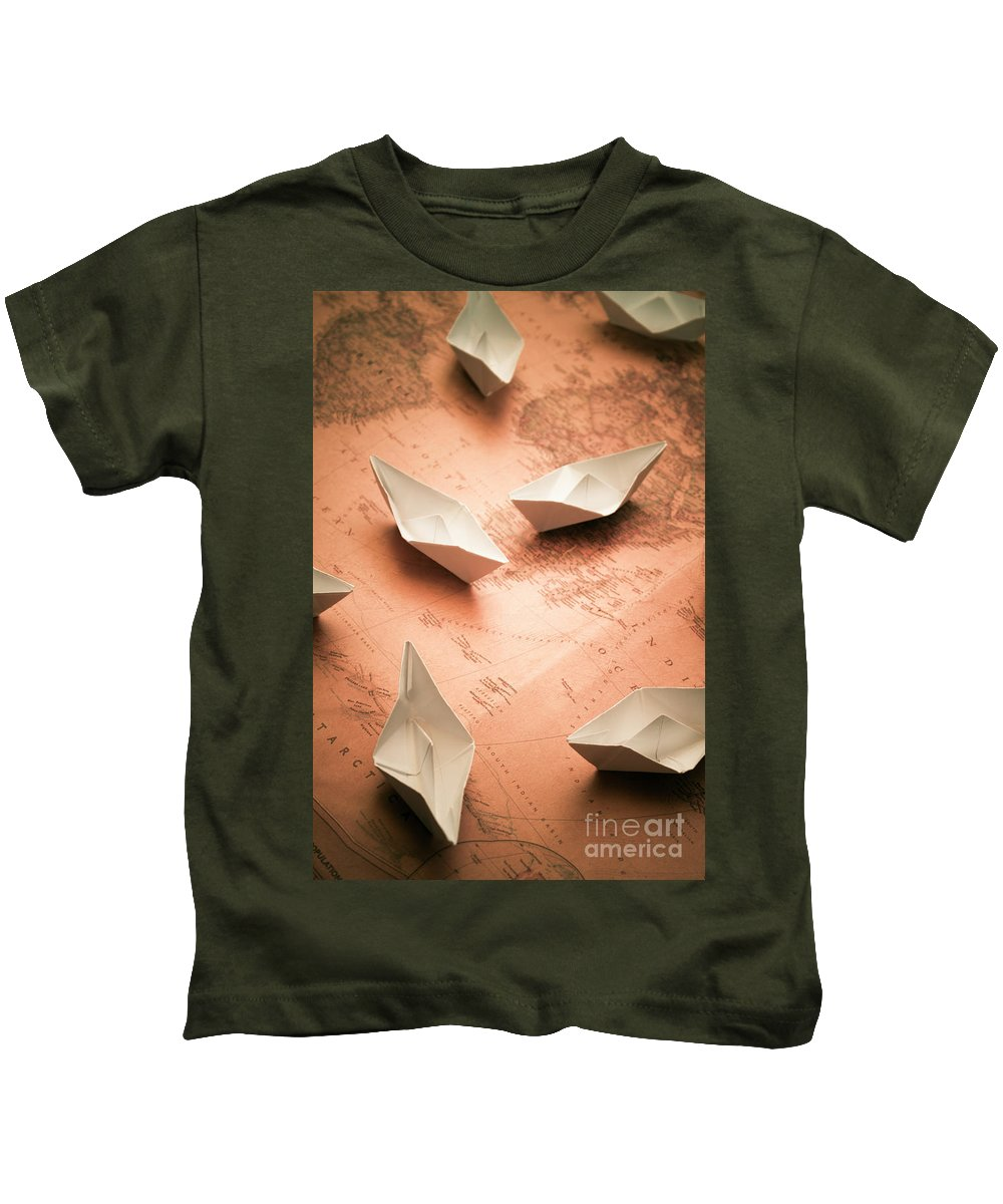 Cruise Kids T-Shirt featuring the photograph Small Paper Boats On Top Of Old Map by Jorgo Photography - Wall Art Gallery