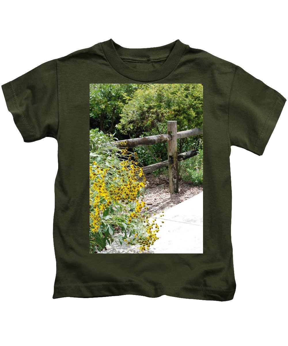 Macro Kids T-Shirt featuring the photograph Sun Flower Fence by Rob Hans