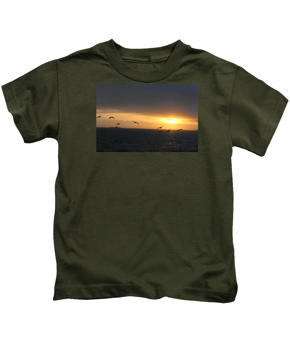 Landscape Kids T-Shirt featuring the photograph Sun-rise Pelican Flight by Kenneth Christenson