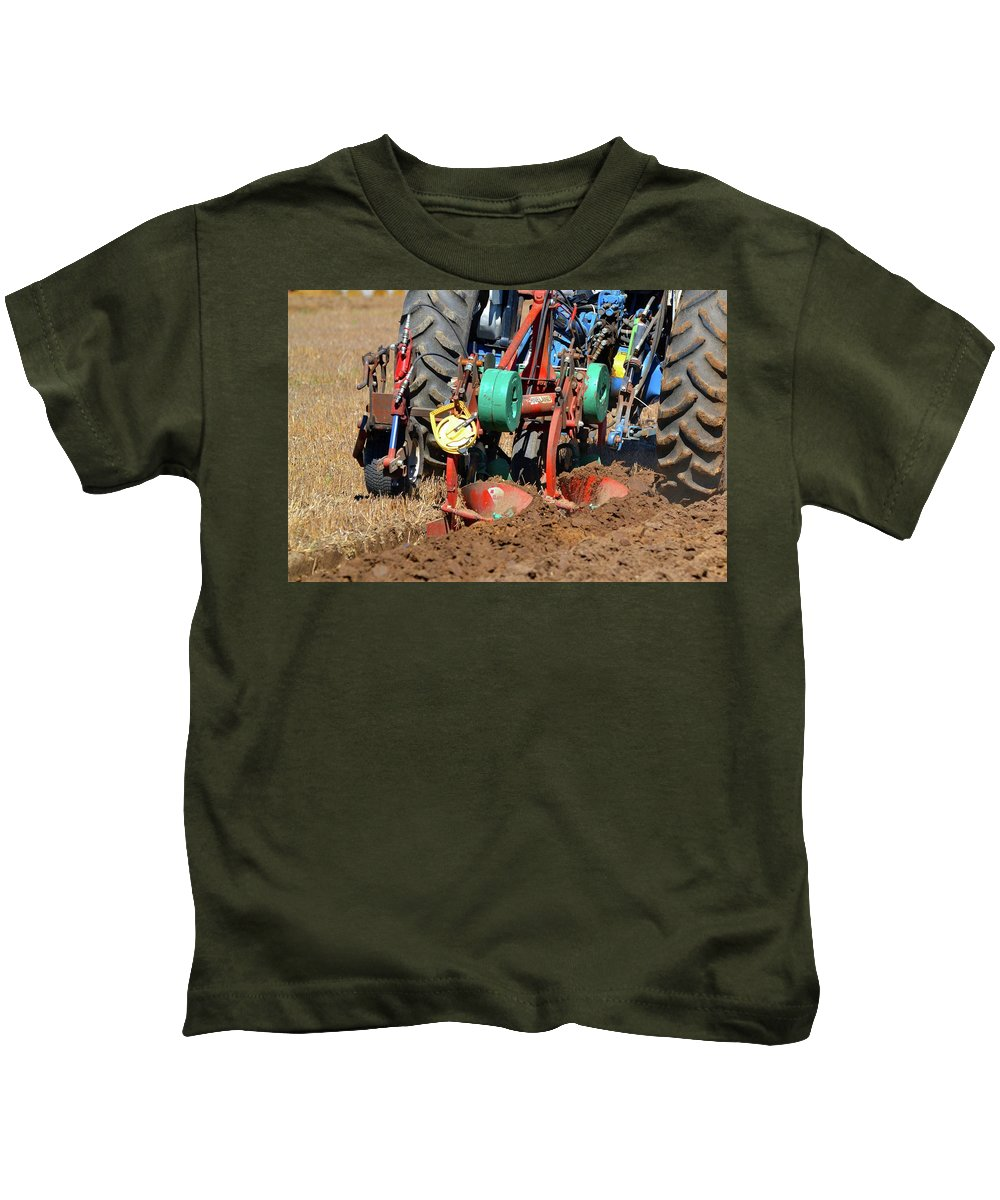 Farm Kids T-Shirt featuring the photograph The Business End Of A Tractor by Lyle Crump