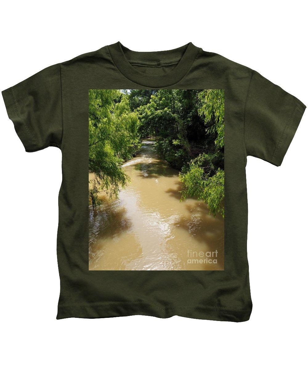 Muddy Kids T-Shirt featuring the photograph The Muddy Medina by Gary Richards