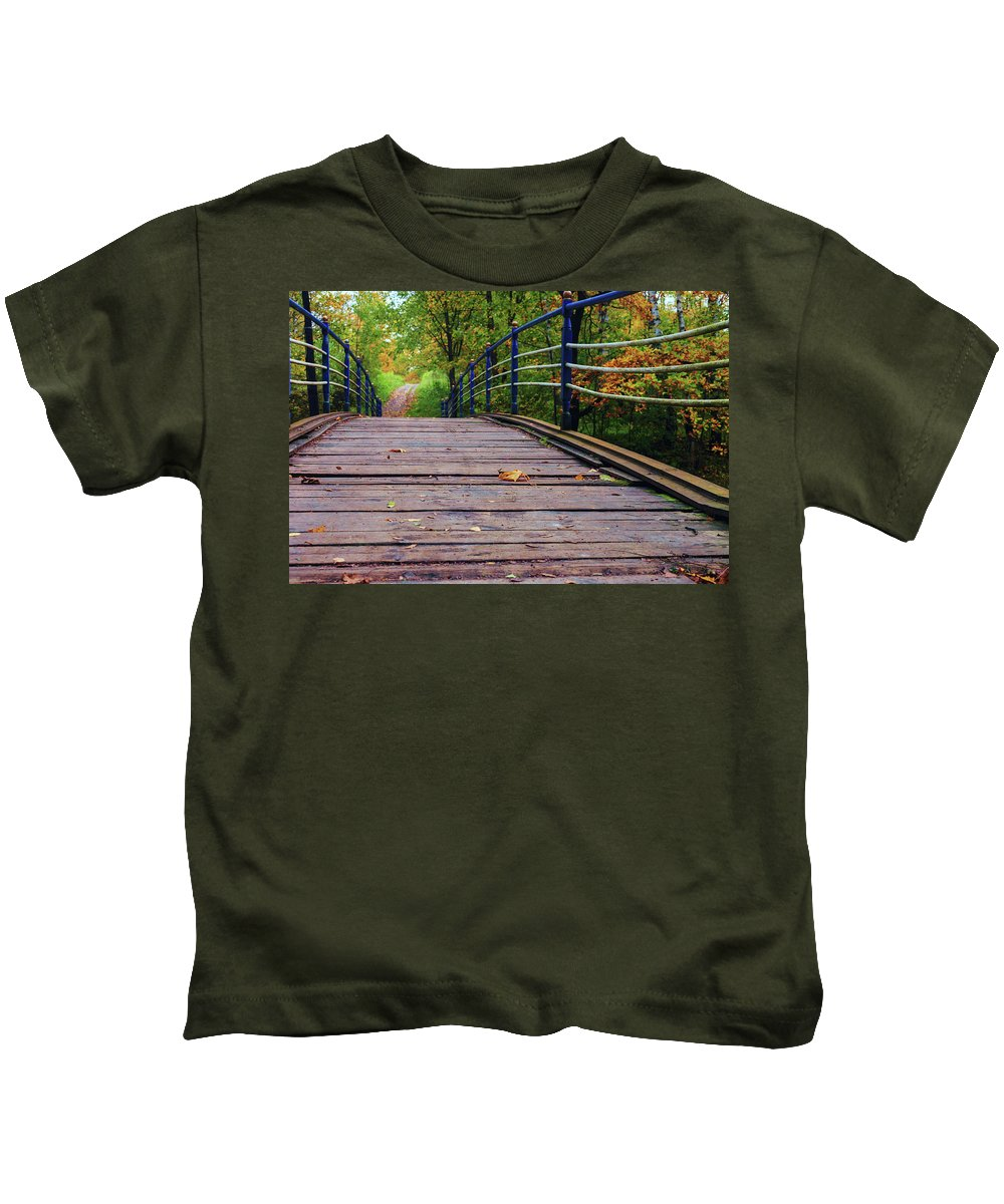 George Westermak Kids T-Shirt featuring the photograph the old bridge over the river invites for a leisurely stroll in the autumn Park by George Westermak