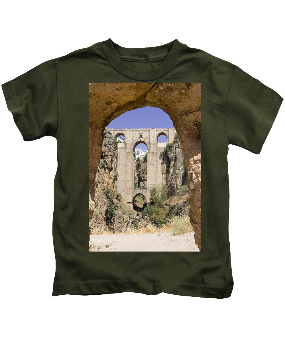 Ronda Kids T-Shirt featuring the photograph The Tajo De Ronda And Puente Nuevo Bridge Andalucia Spain Europe by Mal Bray