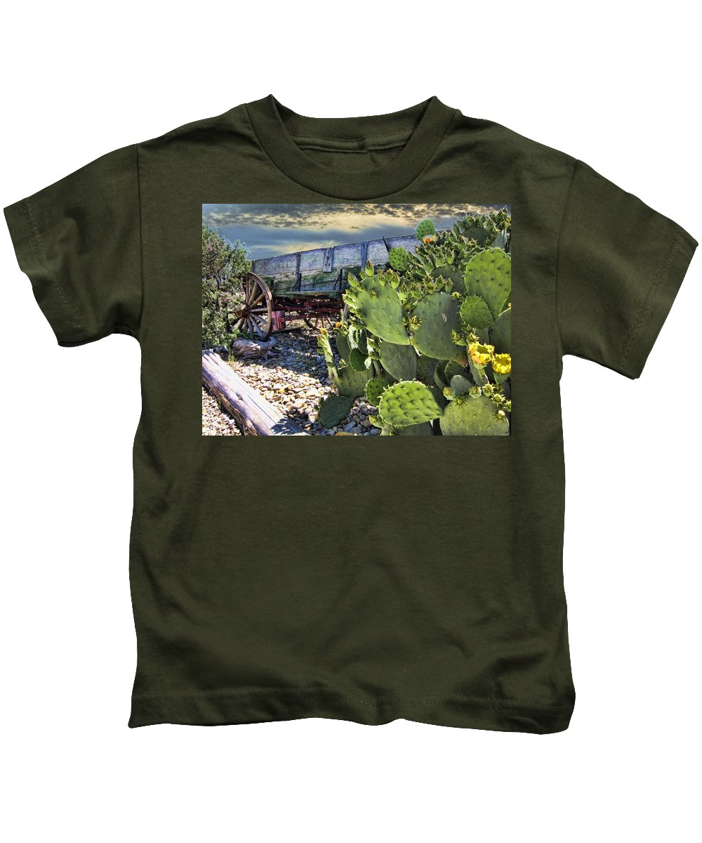 Wagon. Cactus Kids T-Shirt featuring the photograph Transport Of A Forgotten Era by Douglas Barnard