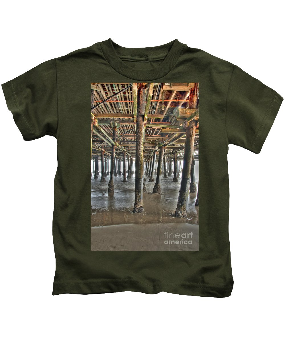 Under The Boardwalk Kids T-Shirt featuring the photograph Under The Boardwalk Pier Sunbeams by David Zanzinger
