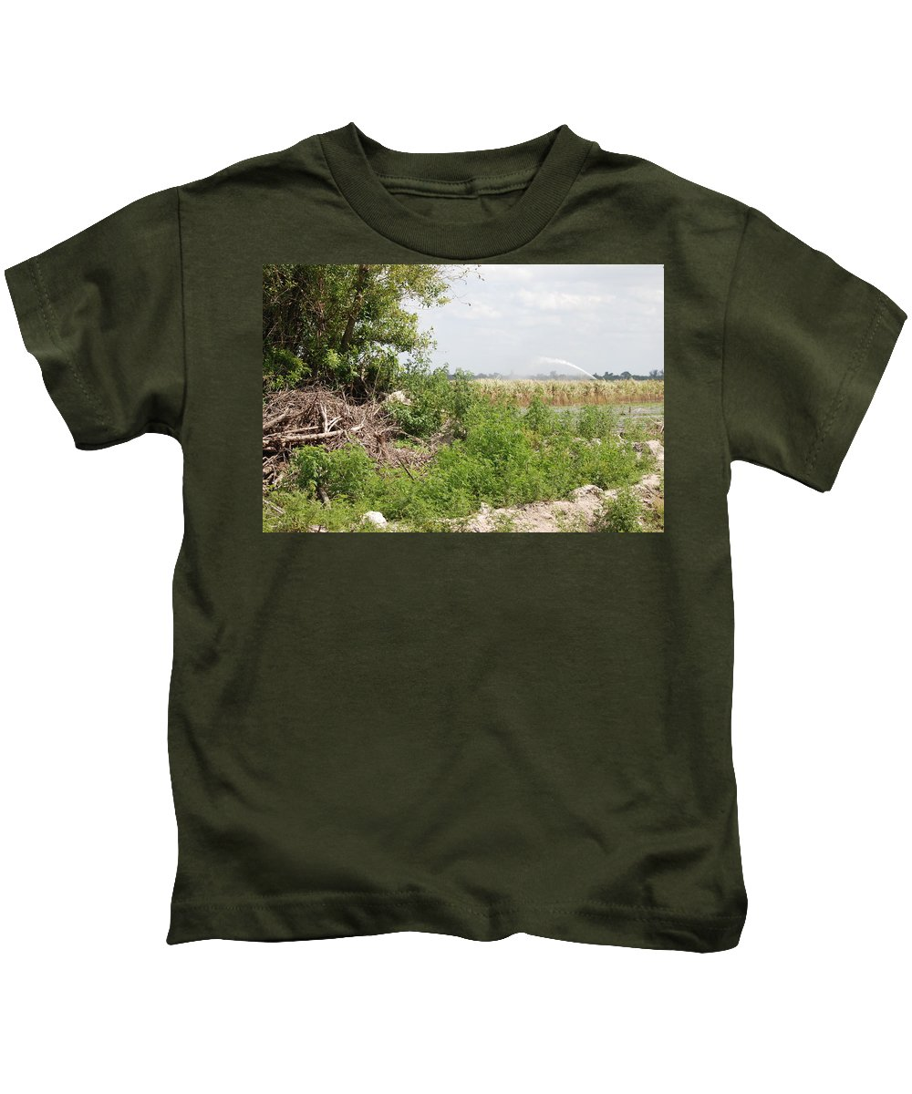 Leaves Kids T-Shirt featuring the photograph Watering The Weeds by Rob Hans