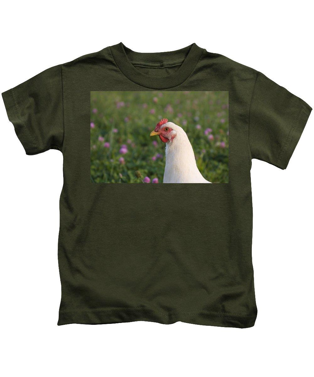 White Chicken Farm Rural Green Grass Bird Kids T-Shirt featuring the photograph White Chicken by Andrei Shliakhau