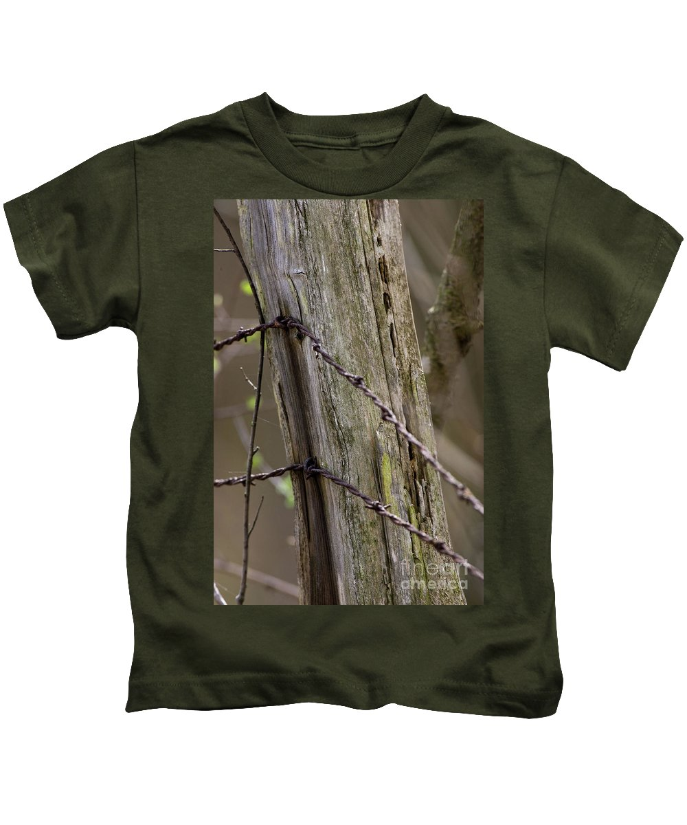 Animal Kids T-Shirt featuring the photograph Wire That Tamed The West by Alan Look