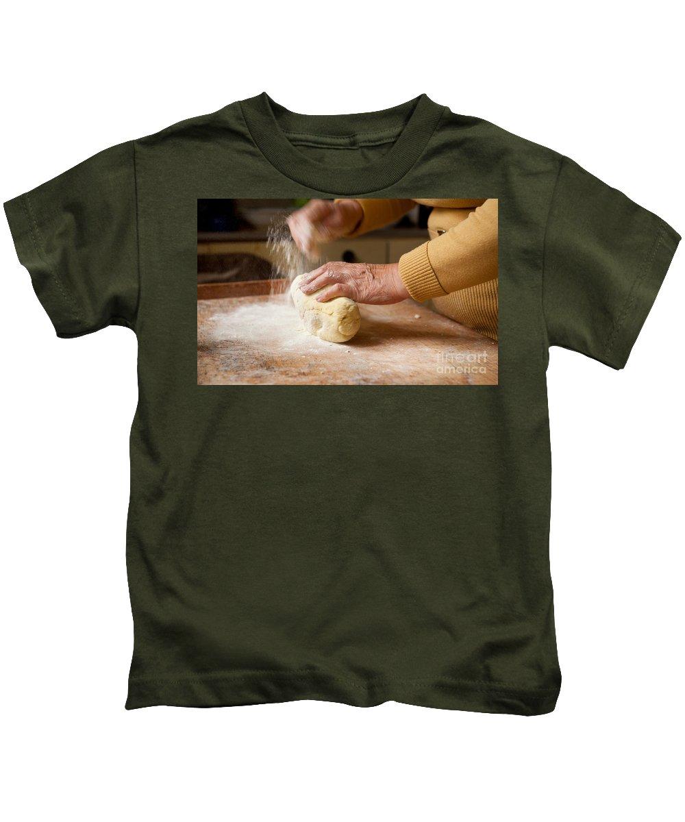 Kopytka Kids T-Shirt featuring the photograph Woman Preparing Dough For Kopytka by Arletta Cwalina