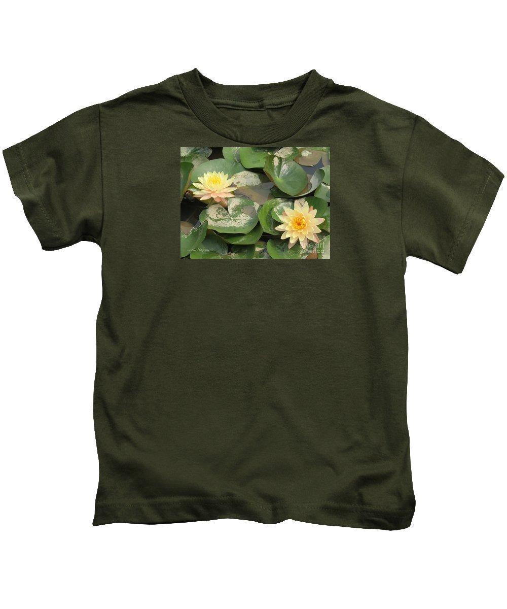 Flowers Kids T-Shirt featuring the photograph Yellow Water Lillies by Mikhael van Aken