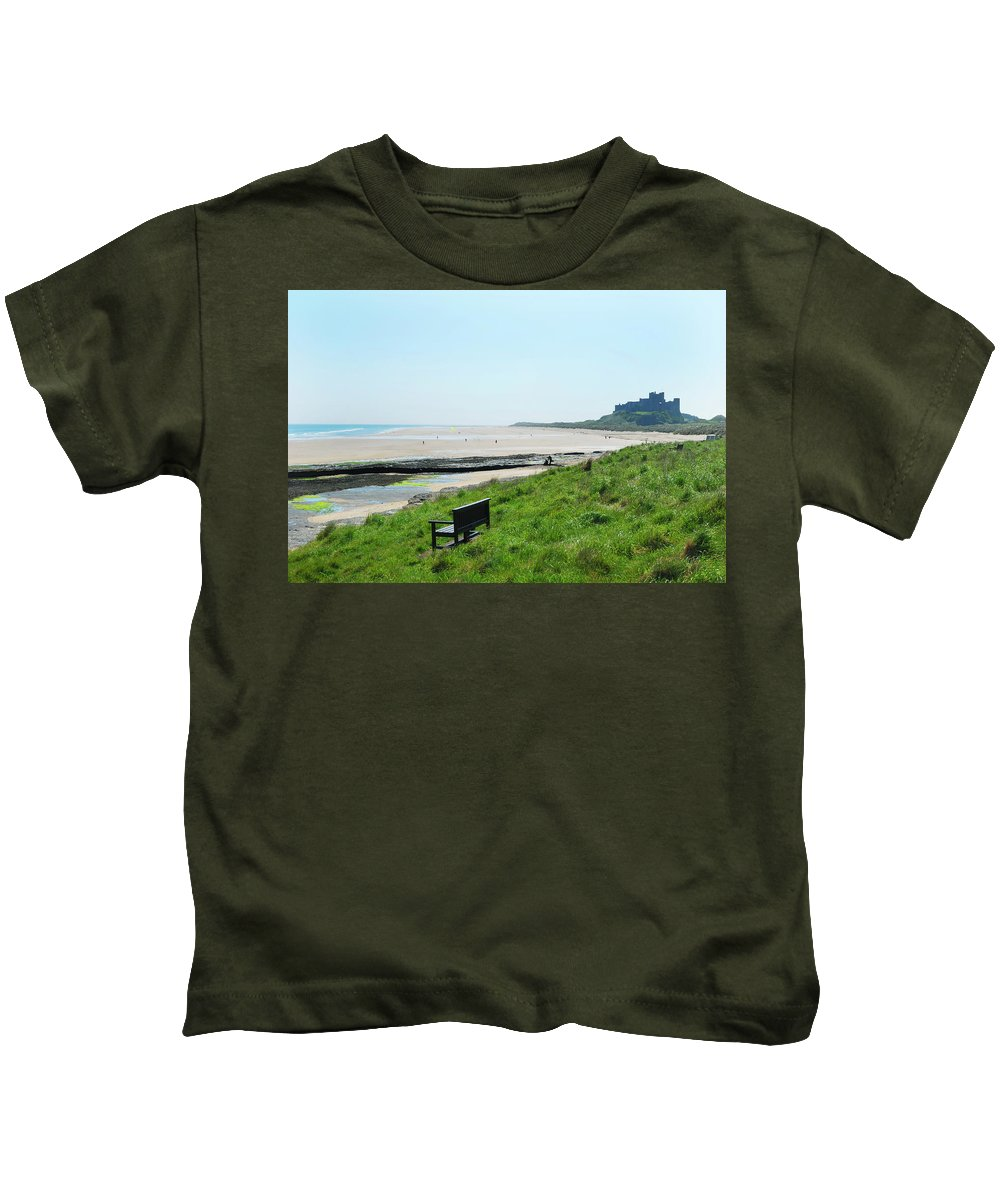 Bamburgh Kids T-Shirt featuring the photograph Bamburgh Castle And Beach by Victor Lord Denovan