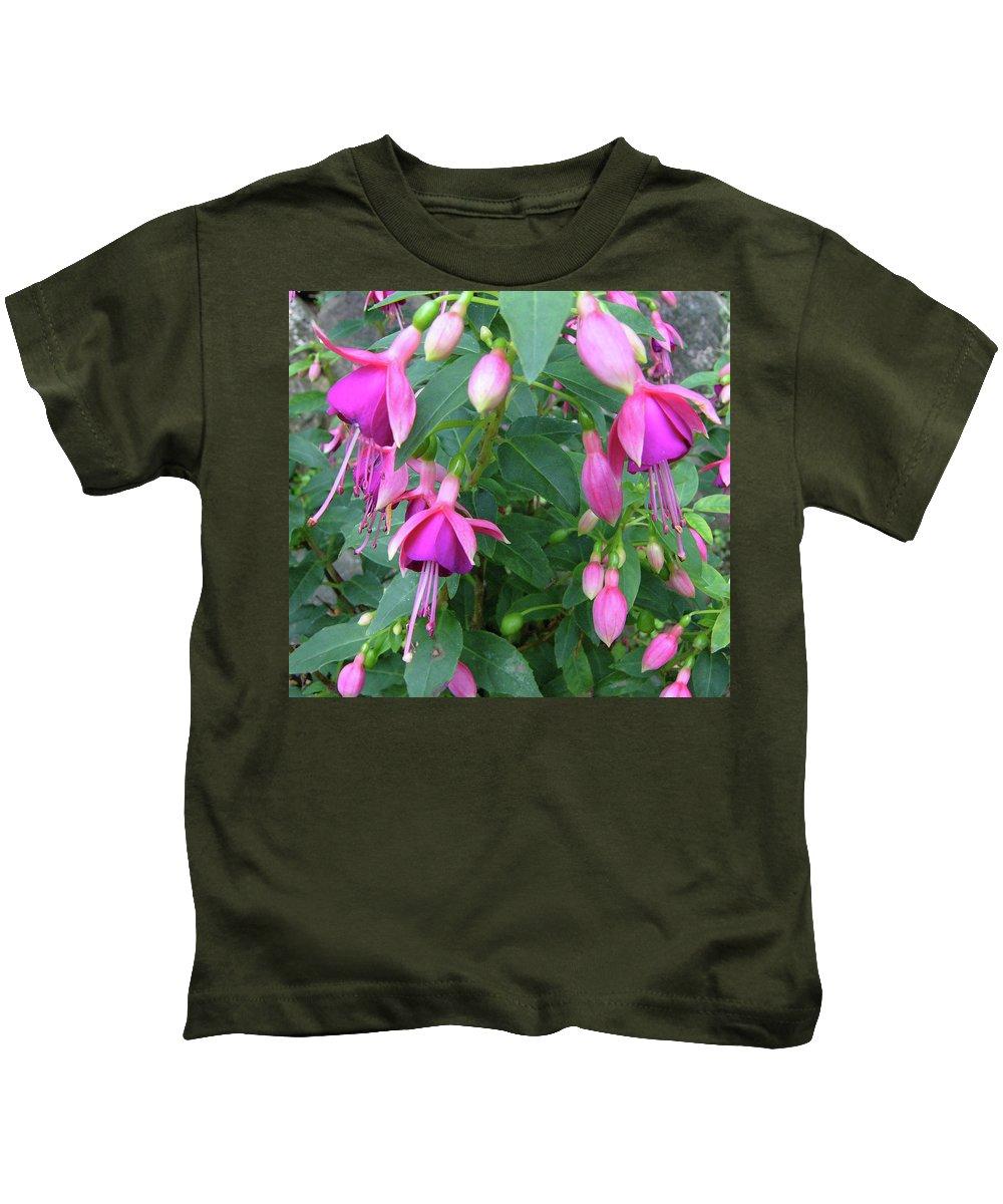 Fuchsia Pink Flower Green Nature Leaves Closeup Kids T-Shirt featuring the photograph Fuchsia by Lisa Bates