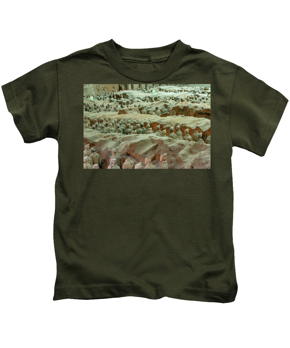 Warrior Kids T-Shirt featuring the photograph Rows Of Terra Cotta Warriors In Pit 1 by Karen Foley