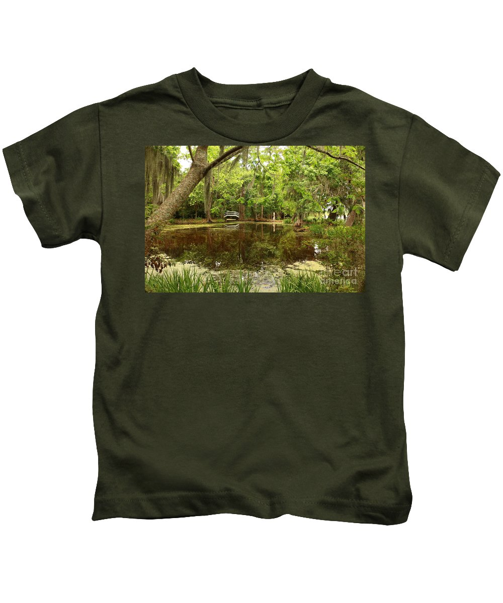Magnolia Plantation Kids T-Shirt featuring the photograph Natural Framing Of A White Magnolia Plantation Bridge  by Christiane Schulze Art And Photography