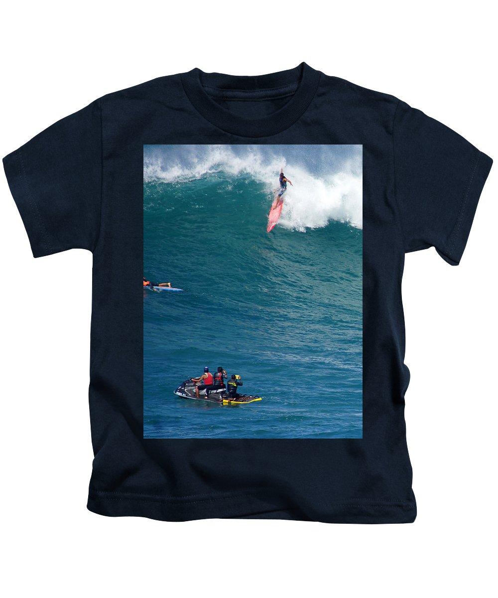 Waimea Bay Kids T-Shirt featuring the photograph Waimea Bay Takeoff by Kevin Smith