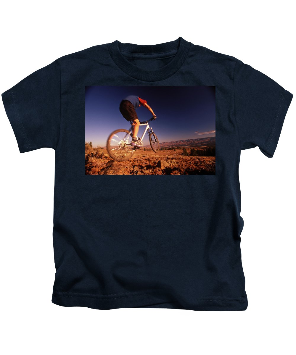 Adult Kids T-Shirt featuring the photograph A Mountain Bike Rider On A Ride by Earl Harper