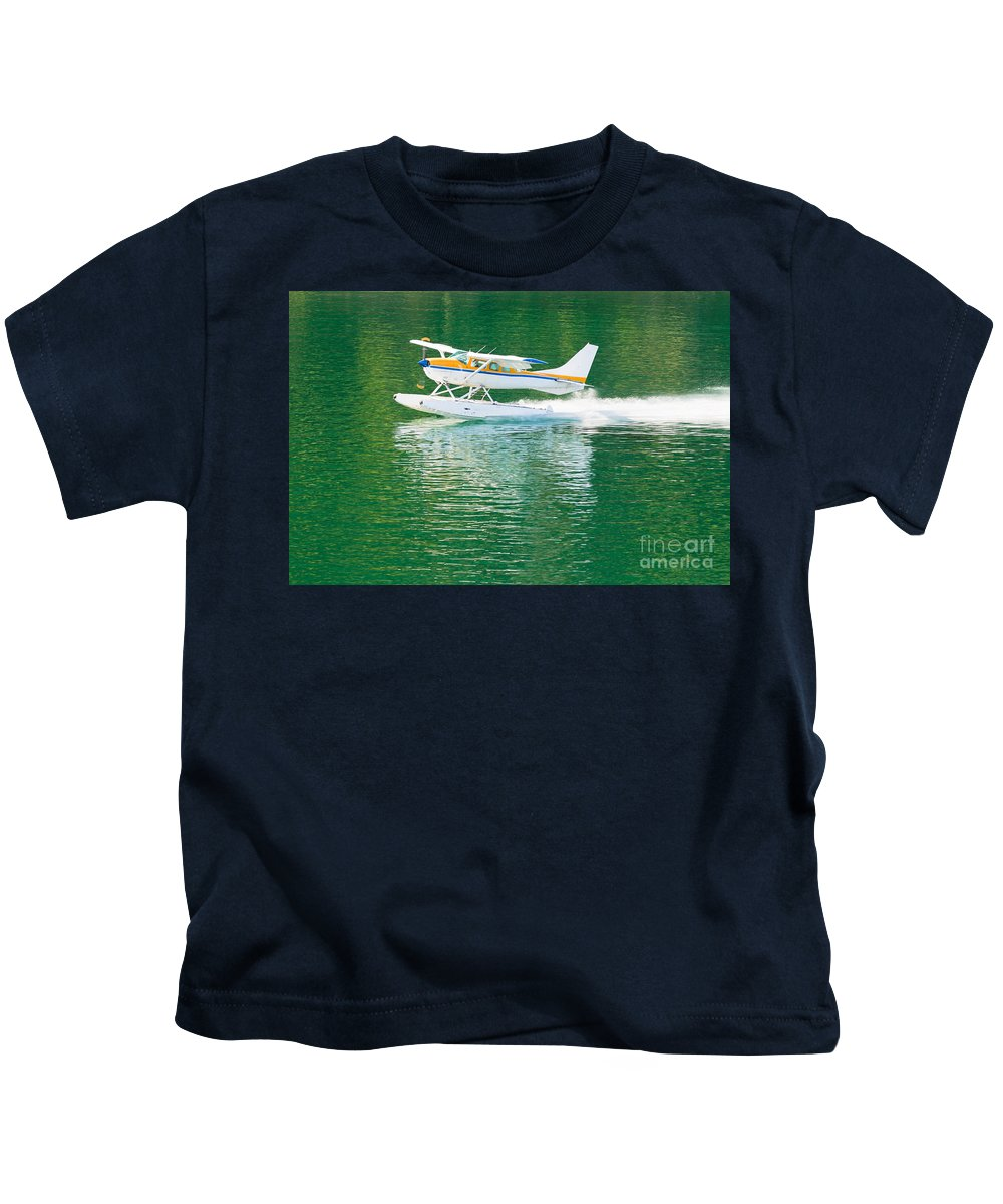 Aeronautical Kids T-Shirt featuring the photograph Aircraft Seaplane Taking Off On Calm Water Of Lake by Stephan Pietzko