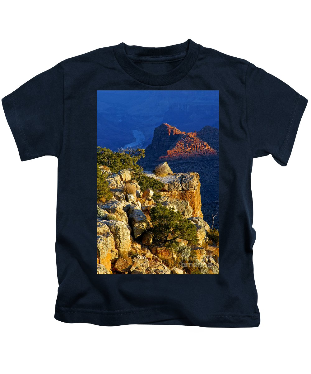 Grand Canyon National Park Arizona Parks South Rim Canyons Rock Formations Rock Formation Sunrise Sunrises Landscape Landscapes Kids T-Shirt featuring the photograph Creeping Morning Canyon Light by Bob Phillips