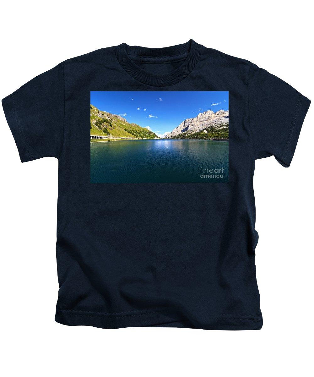Alpine Kids T-Shirt featuring the photograph Dolomites - Fedaia Lake by Antonio Scarpi