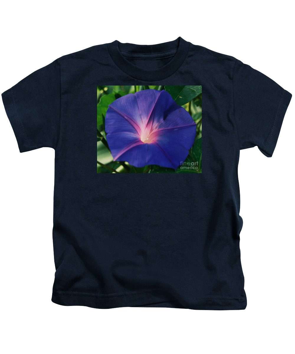 Morning Glory Art Floral Honoring Georgia O'keefe Macro Stock Shot Purple Flower Sunlit White Heart Bermuda Greenery Mauve Colored Veins Natural Beauty Tropical Flora Weed To Some Canvas Print Metal Frame Poster Print Available On Greeting Cards Phone Cases Throw Pillows Tote Bags Shower Curtains Mugs Pouches Weekender Tote Bags And T Shirts Kids T-Shirt featuring the photograph Morning Glory In Bermuda # 1 by Marcus Dagan