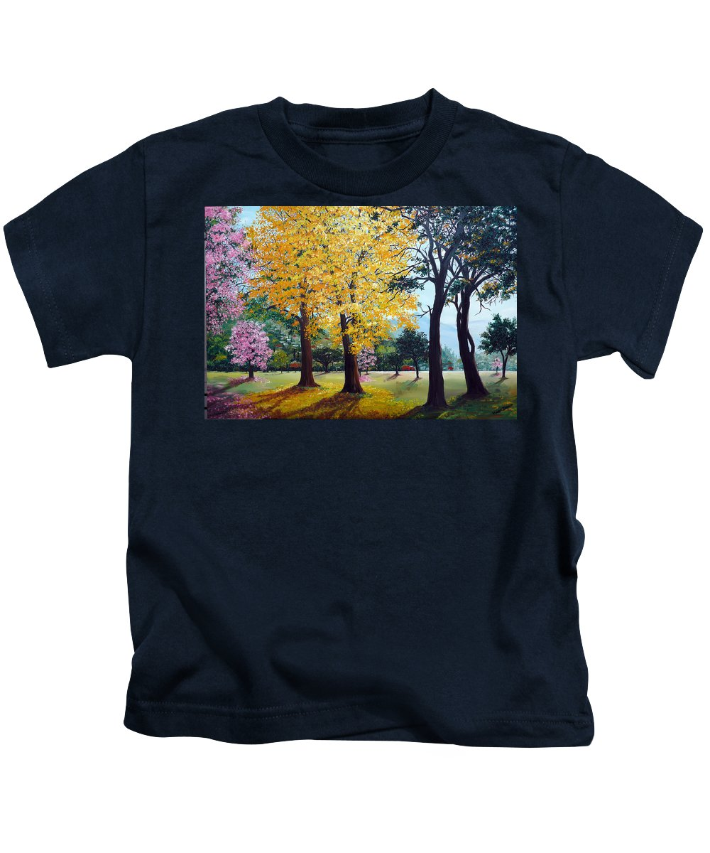 Tree Painting Landscape Painting Caribbean Painting Poui Tree Yellow Blossoms Trinidad Queens Park Savannah Port Of Spain Trinidad And Tobago Painting Savannah Tropical Painting Kids T-Shirt featuring the painting Poui Trees in the Savannah by Karin Dawn Kelshall- Best