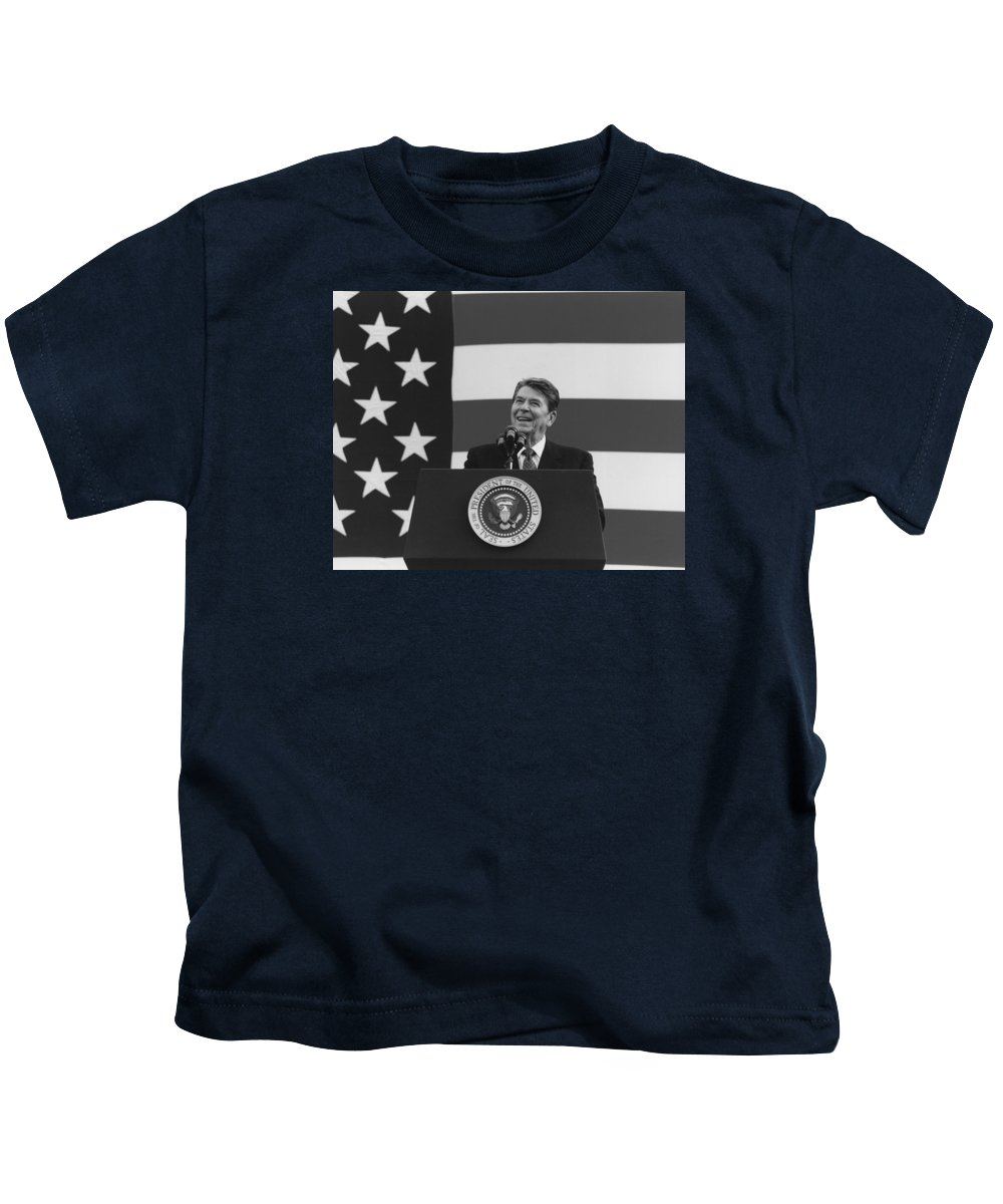 Ronald Reagan Kids T-Shirt featuring the photograph President Reagan American Flag by War Is Hell Store