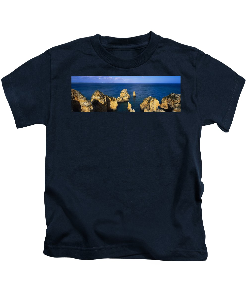 Photography Kids T-Shirt featuring the photograph Rock Formations In The Sea, Algarve by Panoramic Images