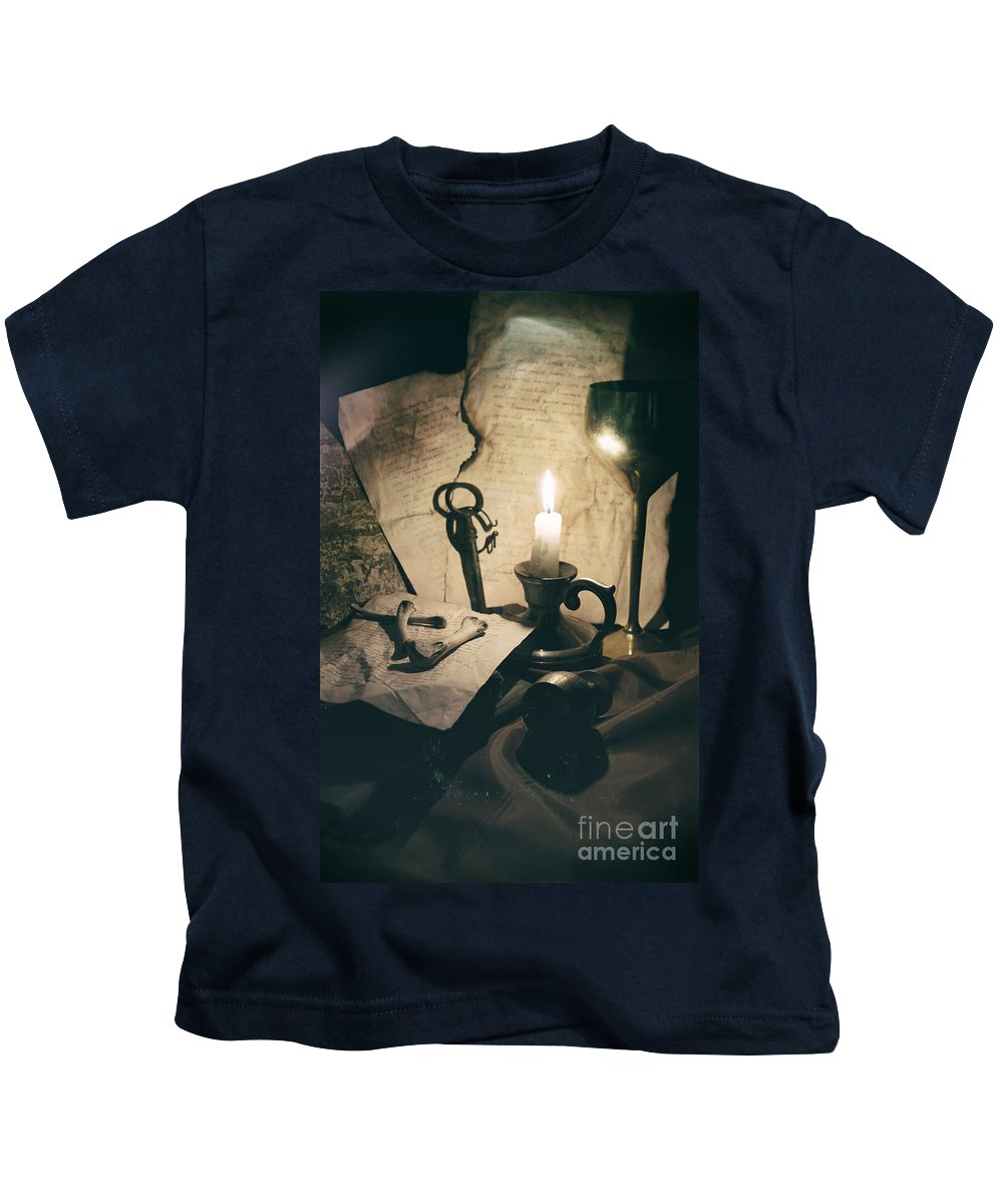 Still Life Kids T-Shirt featuring the photograph Still Life With Bones Rusty Key Wine Glass Lit Candle And Papers by Jaroslaw Blaminsky
