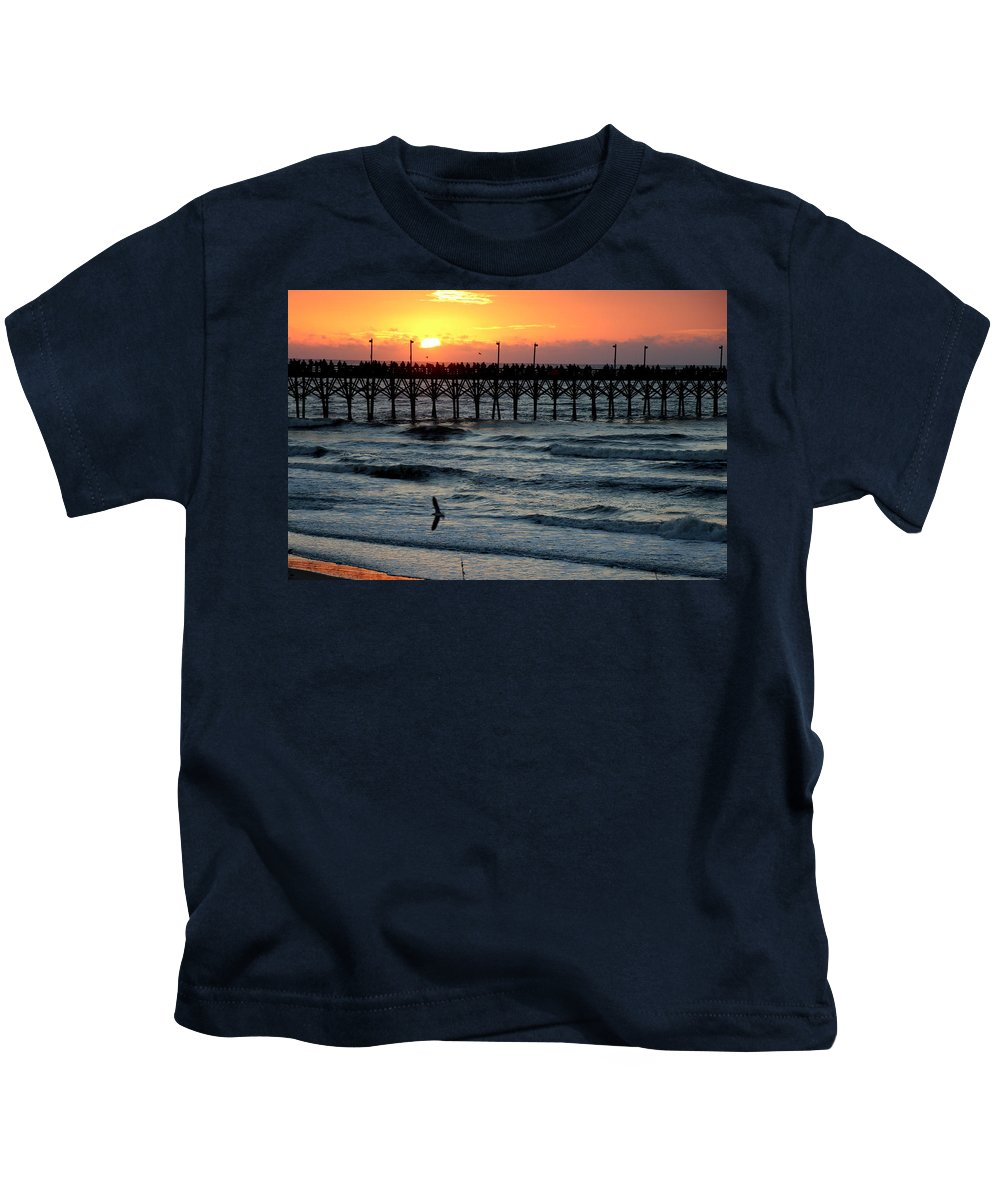 Sun Up Kids T-Shirt featuring the photograph Sun Over Pier And Bird In Surf by Rand Wall