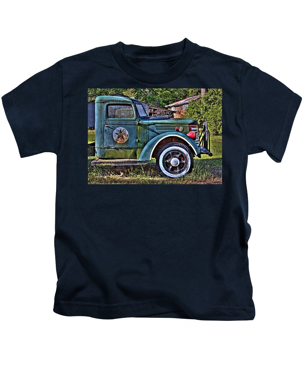 Old Texaco Truck Kids T-Shirt featuring the photograph The Sign Of The Star by Danny Pickens