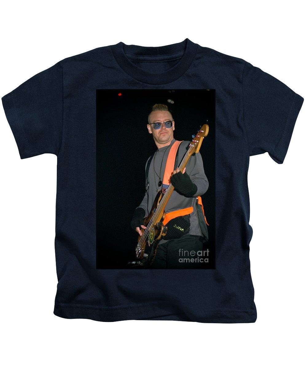 Adam Clayton Kids T-Shirt featuring the photograph U2-adam-gp24 by Timothy Bischoff